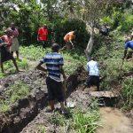 The Water Project: Mahira Community, Jairus Mwera Spring -  Community Members Help Excavate The Spring