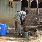 The Water Project: Ebubole UPC Secondary School -  Community Member Helps Mix Cement