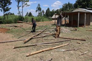The Water Project:  Artisans Ferrying And Cutting Poles