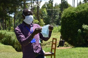 The Water Project:  The Facilitator Demonstrating How To Make A Mask