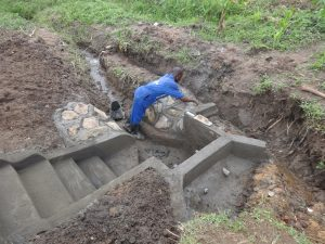 The Water Project:  Cementing The Stone Pitching