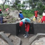 The Water Project: Mahira Community, Kusimba Spring -  Head Wall Plastering