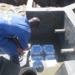 The Water Project: Mahira Community, Jairus Mwera Spring -  Tile Setting