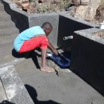 The Water Project: Mahira Community, Kusimba Spring -  Tile Setting
