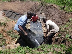 The Water Project:  Backfill With Plastic Tarp