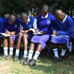The Water Project: St. Teresa's Isanjiro Girls Secondary School -  Students Taking Notes During Training