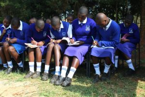 The Water Project:  Students Taking Notes During Training