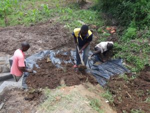 The Water Project:  Soil Backfilling Process