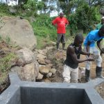 The Water Project: Mahira Community, Kusimba Spring -  Backfilling Clay Works