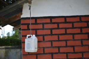 The Water Project:  A Leaky Tin As A Handwashing Station