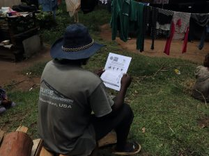 The Water Project:  A Community Member Uses A Handout To Follow Trainings