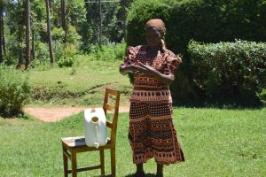 The Water Project:  A Community Member Showing The Group How She Does Her Handwashing