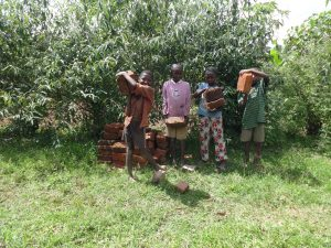 The Water Project:  Kids Help Carry Bricks To The Spring