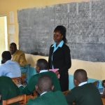 The Water Project: Ebubole UPC Secondary School -  Sanitation Teacher Emphasizing Importance Of Wash