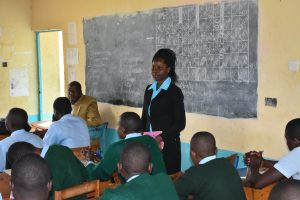 The Water Project:  Sanitation Teacher Emphasizing Importance Of Wash