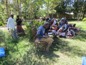 The Water Project:  Participants Taking Notes