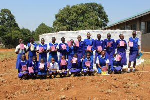 The Water Project:  Students At The Tank Construction Site With Training Booklets
