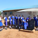 The Water Project: St. Teresa's Isanjiro Girls Secondary School -  Students Posing At The New Rain Tank
