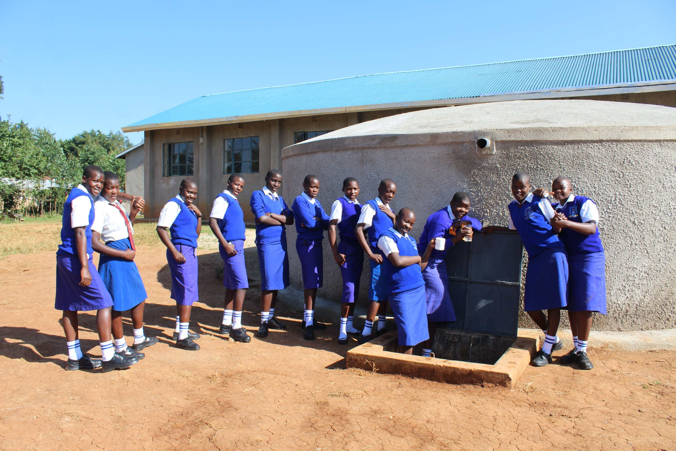 The Water Project : 33-kenya20104-students-posing-at-the-new-rain-tank-2