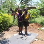 The Water Project: Mahira Community, Jairus Mwera Spring -  Children Pose On Completed Sanplat