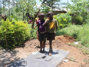 The Water Project:  Children Pose On Completed Sanplat