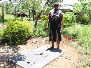 The Water Project:  Posing On A Completed Sanplat