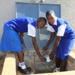 The Water Project: St. Teresa's Isanjiro Girls Secondary School -  Students Collecting Water At The Completed Water Tank