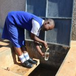 The Water Project: St. Teresa's Isanjiro Girls Secondary School -  Collecting Water At The Completed Water Tank