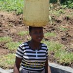 The Water Project: Mahira Community, Jairus Mwera Spring -  Agness Ready To Bring Clean Water Home
