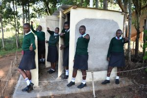 The Water Project:  Girls Posing At Their New Latrines