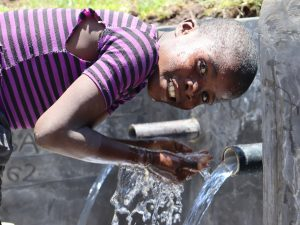 The Water Project:  A Child Enjoying Water