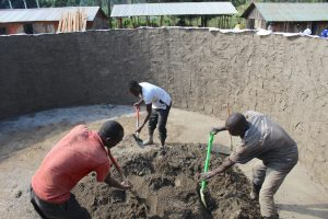 The Water Project:  Community Members Help With Cement Work