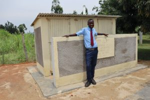 The Water Project:  Student At Finished Latrine