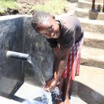 The Water Project: Mahira Community, Jairus Mwera Spring -  A Girl Enjoying The Water