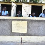 The Water Project: Ebubole UPC Secondary School -  Boys Posing At Their New Latrines