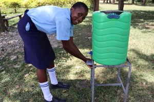 The Water Project:  A Girl Using The Handwashing Station