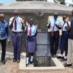 The Water Project: Friends School Vashele Secondary -  Trainer Jonathan Students And Staff At The Water Tank