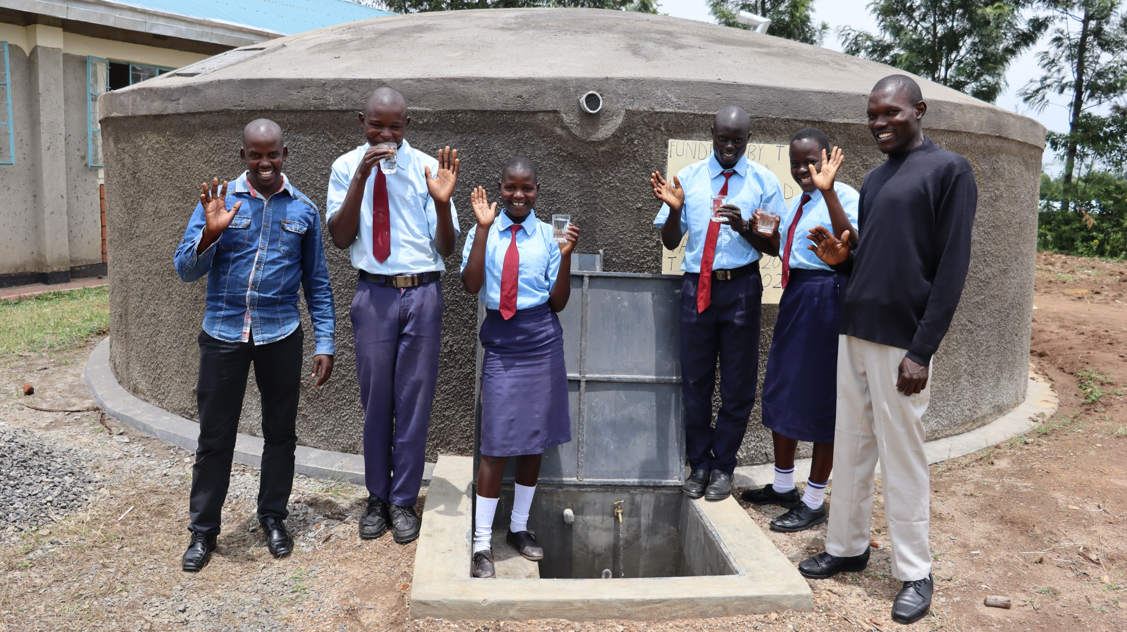 The Water Project : 45-kenya20109-trainer-jonathan-students-and-staff-at-the-water-tank-1