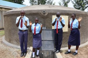 The Water Project:  Students Posing At The Water Tank