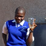 The Water Project: St. Teresa's Isanjiro Girls Secondary School -  Student Gladys Raises A Glass Of Water