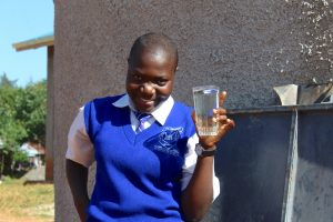 The Water Project:  Student Gladys Raises A Glass Of Water