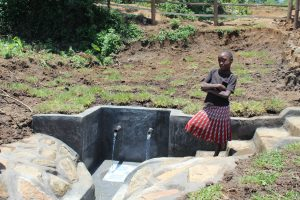 The Water Project:  A Girl Poses By The Newly Completed Spring