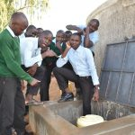 The Water Project: Ebubole UPC Secondary School -  Student Collecting Water