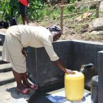 The Water Project: Mahira Community, Kusimba Spring -  Fetching Water
