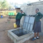 The Water Project: Ebubole UPC Secondary School -  Posing At The Rain Tank