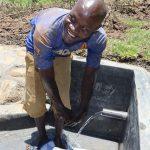 The Water Project: Mahira Community, Jairus Mwera Spring -  Mr Mwera Enjoying Water