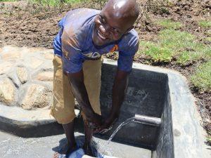 The Water Project:  Mr Mwera Enjoying Water