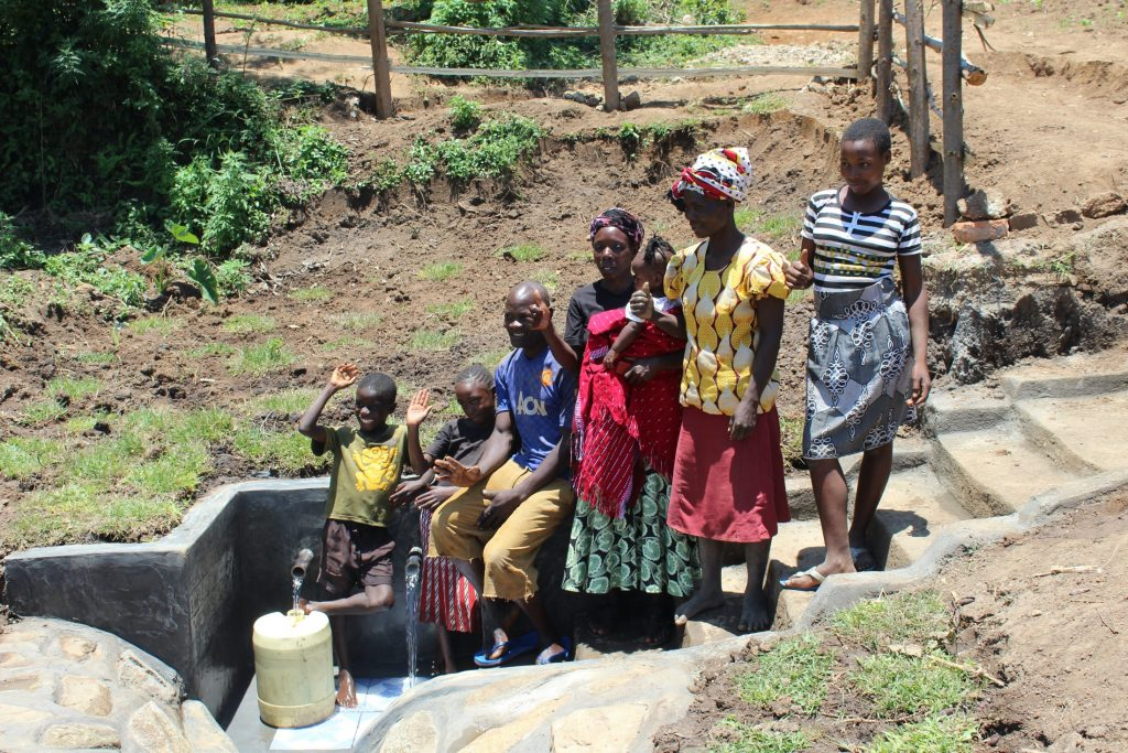 The Water Project : 55-kenya20162-community-members-posing-at-the-spring