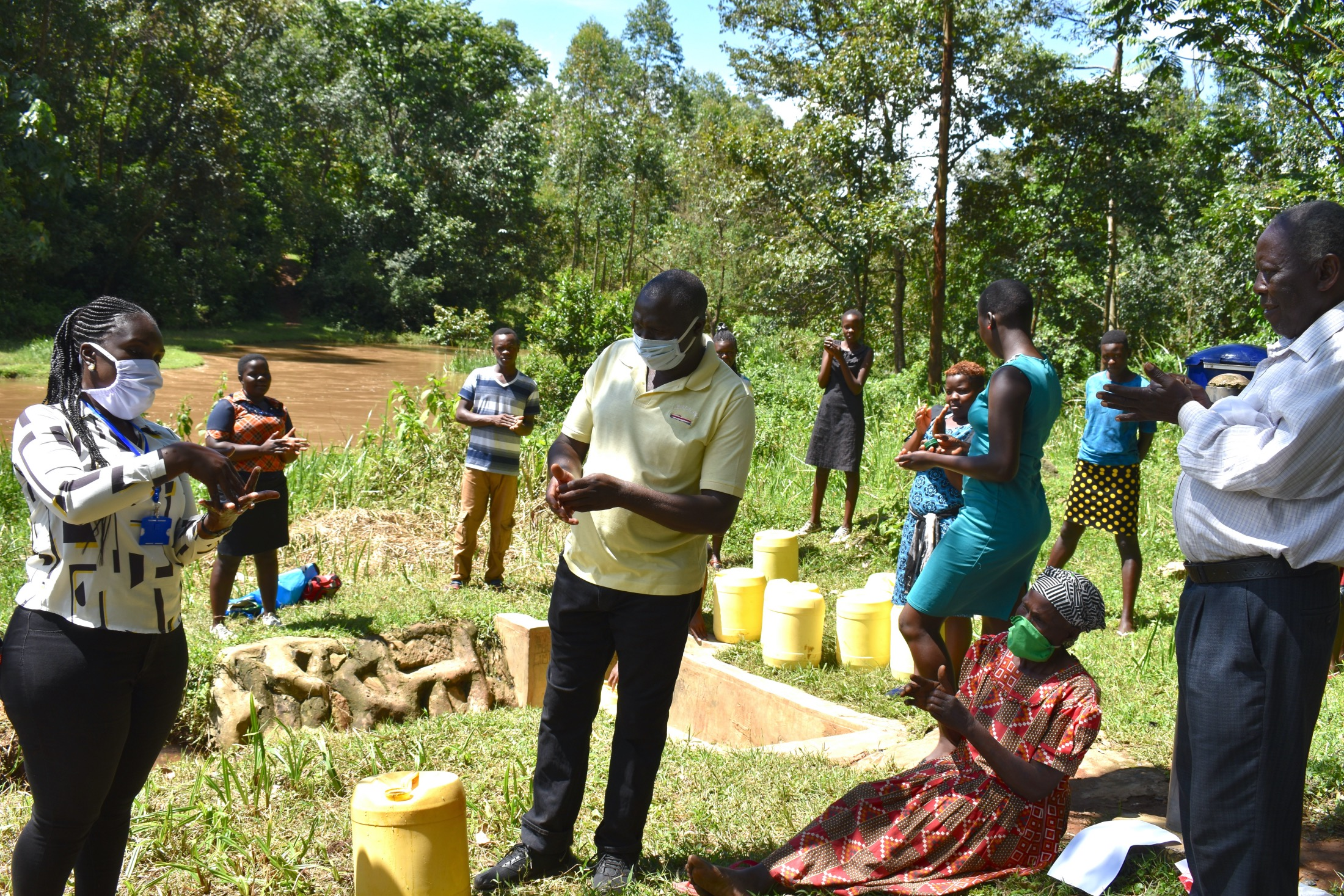 The Water Project : 6-covid19-kenya18096-trainer-alulu-leading-the-handwashing-exercise