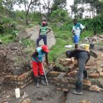 The Water Project: Mahira Community, Kusimba Spring -  Pipe Setting